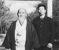 The Founder of Aikido O Sensei & His pupil Morihiro Saito Sensei 9th Dan in front of the Aiki Shrine