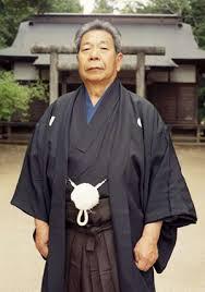 Morihiro Saito Sensei 9th Dan (1928-2002) in front of the Aiki Shrine